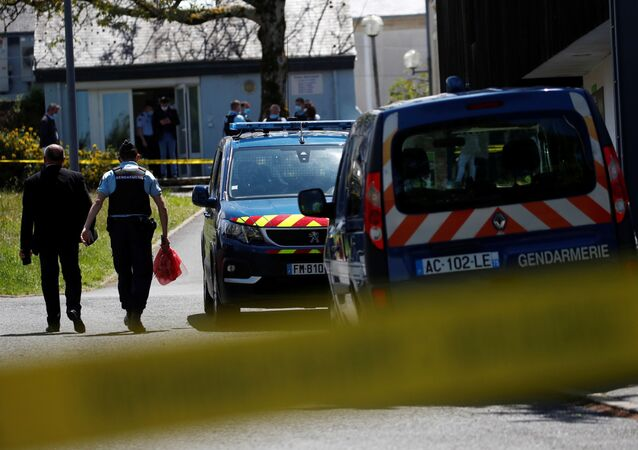 French gendarmes stand in front of the municipal police after an assailant stabbed and badly wounded a policewoman in La Chapelle-sur-Erdre, western France, 28 May 2021