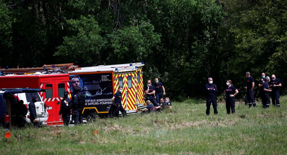 French special police forces and firefighters are seen after an assailant stabbed and badly wounded a policewoman in La Chapelle-sur-Erdre, western France, May 28, 2021.