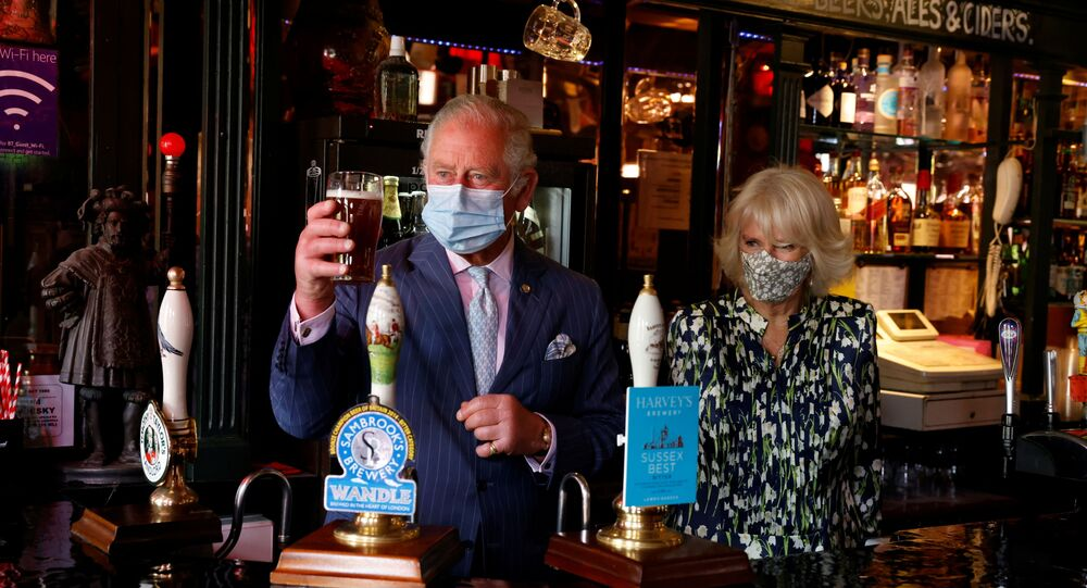 Britain's Prince Charles and Camilla, the Duchess of Cornwall visit Clapham Old Town in London, Britain, May 27, 2021.