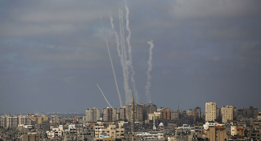 Rockets are launched from the Gaza Strip towards Israel, in Gaza City, Thursday, May 20, 2021.
