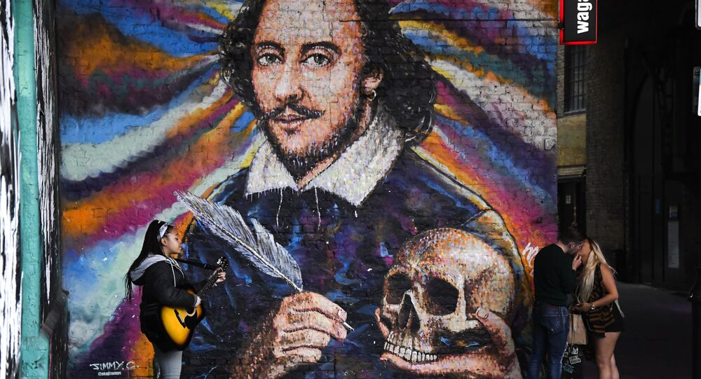 A girl plays guitar and a couple kiss under a mural depicting William Shakespeare on the south bank of river Thames, as the capital is set to reopen after the lockdown due to the coronavirus outbreak, in London, Saturday, July 4, 2020.