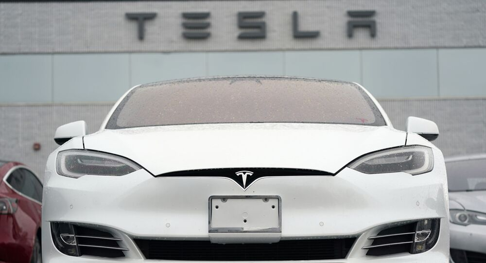 In this Sunday, 9 May 2021, photograph, an unsold S70 sedan sits at a Tesla dealership in Littleton, Colorado, US.