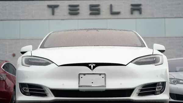 In this Sunday, May 9, 2021, photograph, an unsold S 70 sedan sits at a Tesla dealership in Littleton, Colo. - Sputnik International