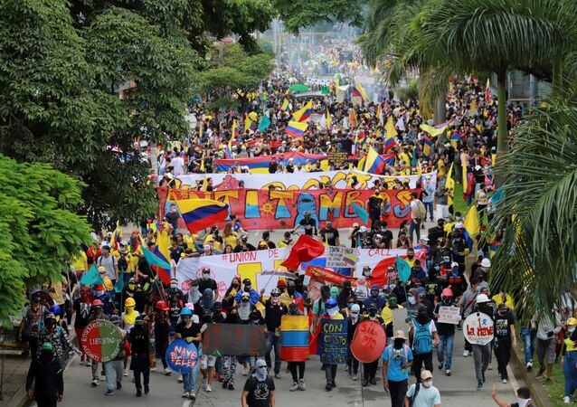 People take part in a protest demanding government action to tackle poverty, police violence and inequalities in healthcare and education systems, in Cali, Colombia May 28, 2021.