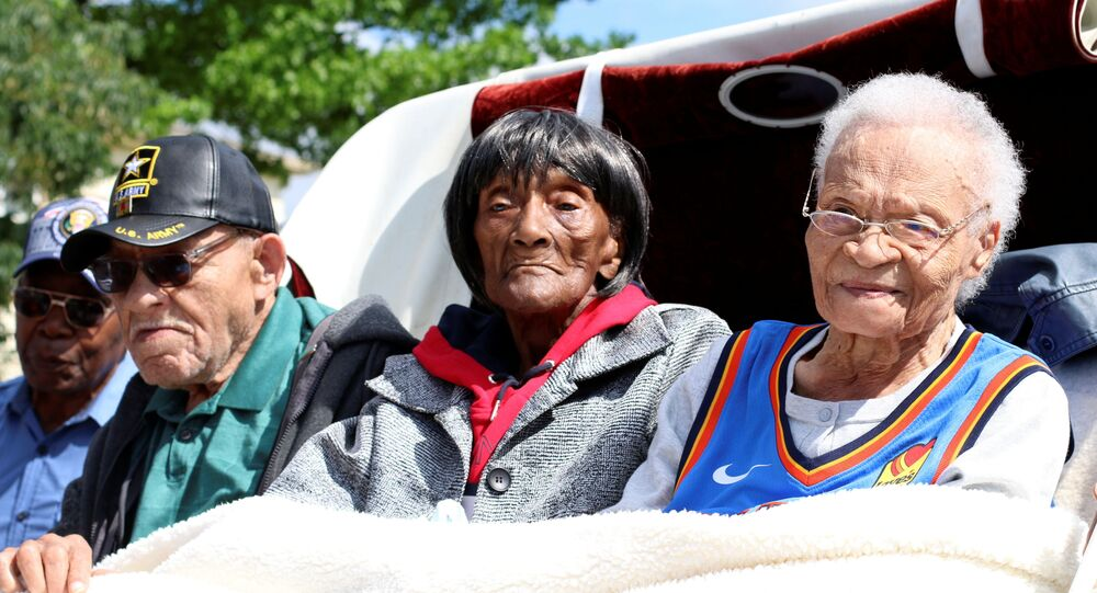 Hughes Van Ellis, 100, Lessie Benningfield Randle, 106, also known as Mother Randle, and Viola Fletcher, 107, the oldest living survivor of the Tulsa Race Massacre and older sister of Van Ellis, attend the Black Wall Street Legacy Festival 2021 in Tulsa, Oklahoma, U.S., May 28, 2021.