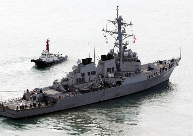 The U.S. Navy's Aegis destroyer USS John S. McCain (DDG-56) leaves a naval port in Busan, South Korea, Monday, March 30, 2009.