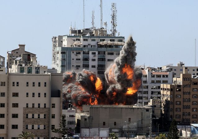 Smoke billows from a building housing various international media, including The Associated Press, after an Israeli airstrike on Saturday, May 15, 2021 in Gaza City.