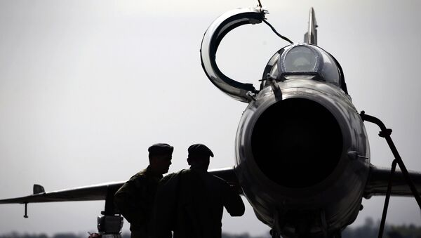 In this Wednesday, April 6, 2016 photo, ground crew prepares a Mig 21 fighter jet for a flight at the military airport Batajnica, near Belgrade, Serbia - Sputnik International