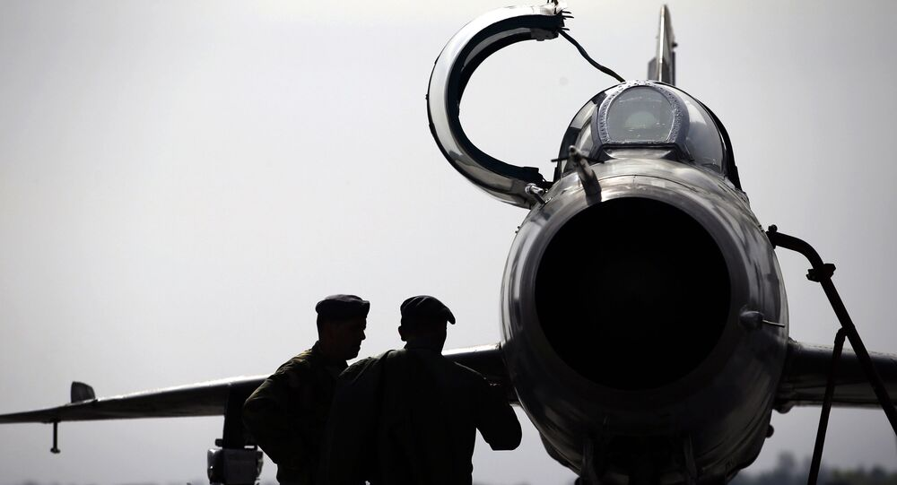 In this Wednesday, April 6, 2016 photo, ground crew prepares a Mig 21 fighter jet for a flight at the military airport Batajnica, near Belgrade, Serbia