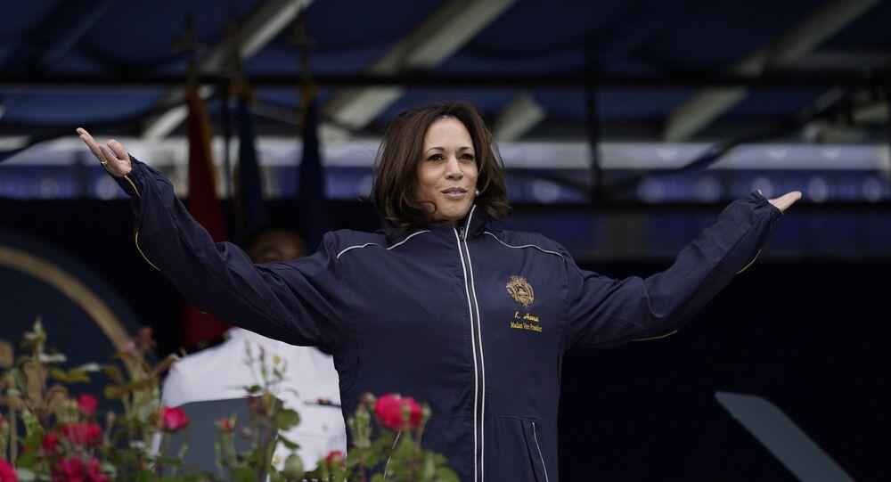 Vice President Kamala Harris displays her U.S. Naval Academy jacket at the graduation and commission ceremony at the U.S. Naval Academy in Annapolis, Md., Friday, May 28, 2021.