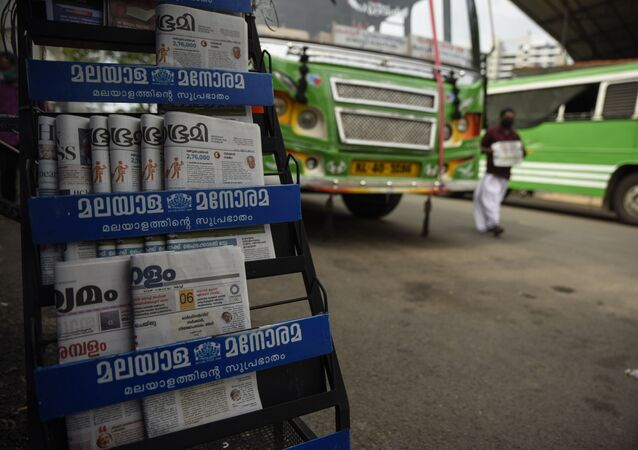 Indian newspapers are displayed for sale outside a shop at a bus terminus which has been shut down for more than a month as part of measures to curb the spread of the COVID-19 pandemic in Kochi, Kerala state, India, Wednesday, April 29, 2020