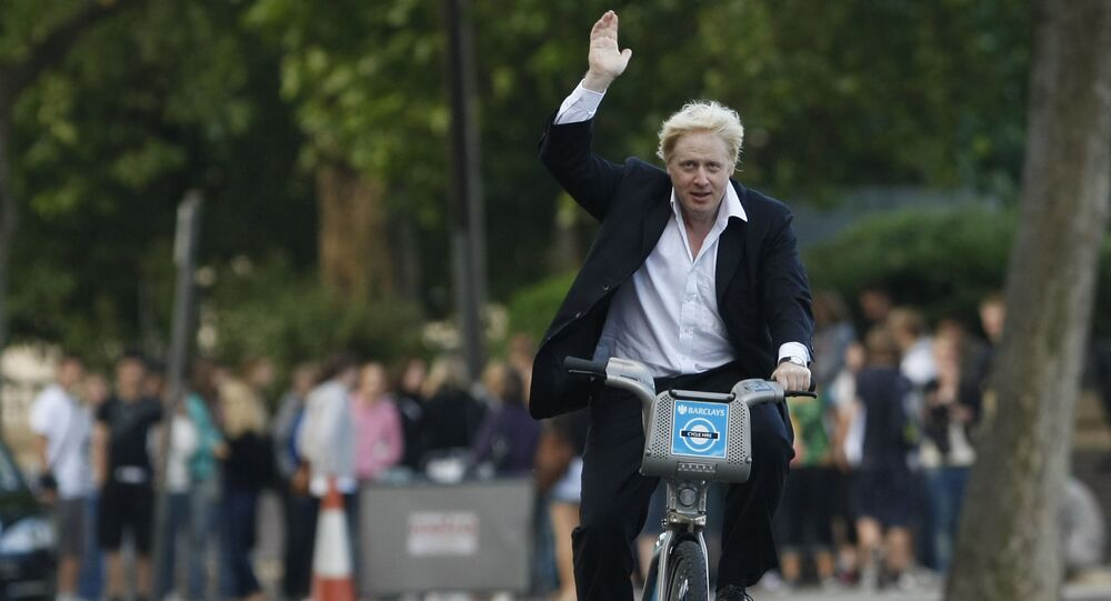 Boris Johnson Mayor of London waves to the media as he helps launch a new cycle hire scheme in London, Friday, July 30, 2010