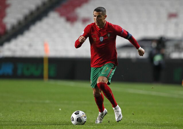 Portugal's Cristiano Ronaldo runs with the ball during the UEFA Nations League soccer match between Portugal and France at the Luz stadium in Lisbon, November 2020