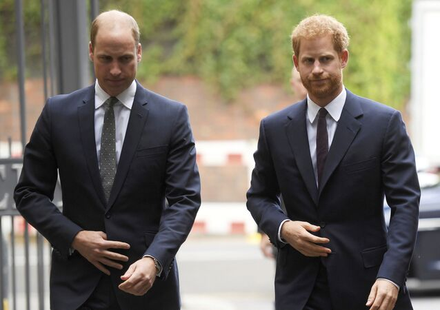 In this Tuesday, 5 September 2017 file photo, Britain's Prince William, the Duke of Cambridge, left, and Prince Harry arrive to visit the Support4Grenfell Community Hub in London