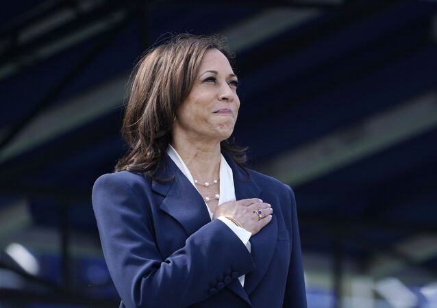 Vice President Kamala Harris stands during the National Anthem at the graduation and commissioning ceremony at the U.S. Naval Academy in Annapolis, Md., Friday, May 28, 2021