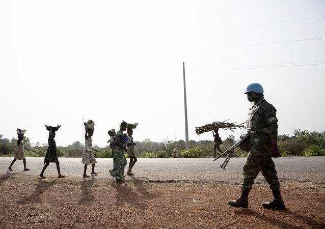 Rwandan MINUSCA peacekeeping forces patrol outside Bangui, Central African Republic, Saturday Jan. 23, 2021.