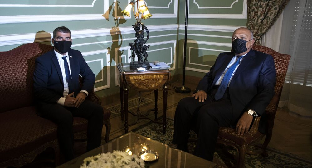 Egyptian Foreign Minister Sameh Shoukry, right, meets with Israeli Foreign Minister Gabi Ashkenazi, at the Tahrir Palace in Cairo, Egypt, Sunday, May 30, 2021.