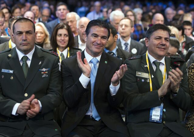 Israeli National Security Adviser Yossi Cohen, center, applauds National Security Adviser Susan Rice as she addresses the 2015 American Israel Public Affairs Committee (AIPAC) Policy Conference in Washington, Monday, March 2, 2015.