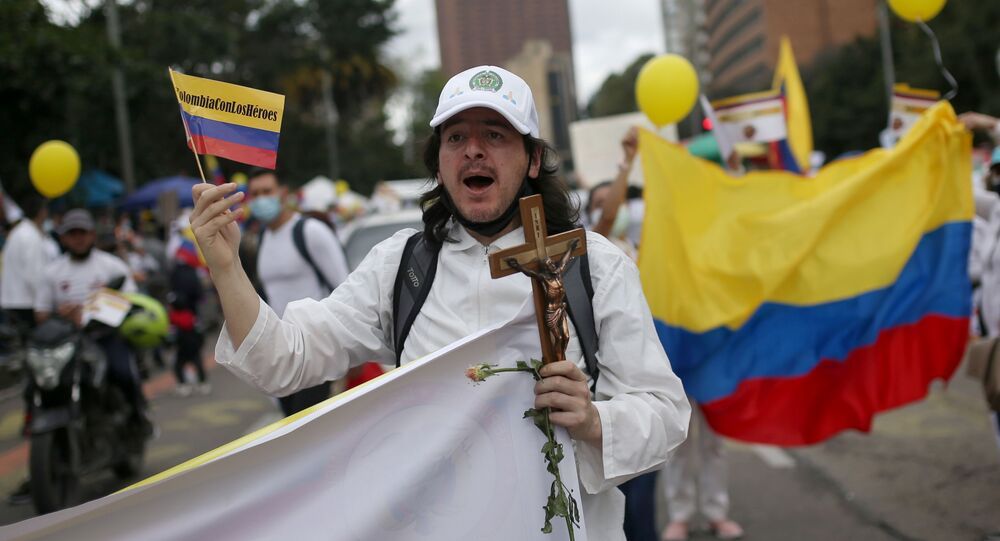 A man gestures as people march in opposition to road blockades and violence after a month of national protests, in Bogota, Colombia May 30, 2021.