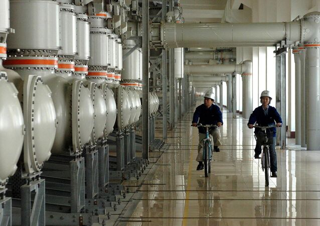 Two technicians do routine inspection work in the hydropower plant on the left bank of the Three Gorges project in central China's Hubei Province Friday, April 30, 2004