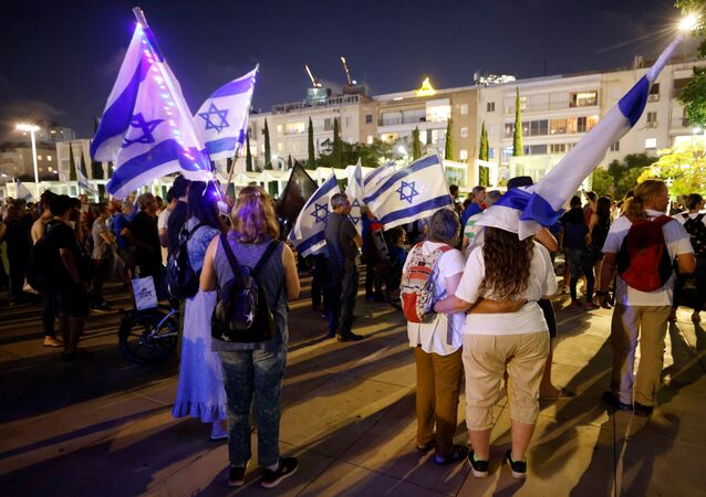 People attend a rally in support of a so-called government of change, a day after far-right party leader Naftali Bennett threw his crucial support behind a unity government in Israel to unseat Prime Minister Benjamin Netanyahu, in Tel Aviv, Israel May 31, 2021