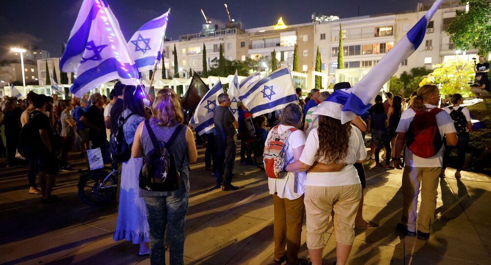 People attend a rally in support of a so-called government of change, a day after right-wing party leader Naftali Bennett threw his crucial support behind a unity government in Israel to unseat Prime Minister Benjamin Netanyahu, in Tel Aviv, Israel May 31, 2021