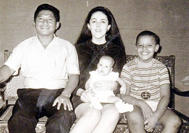 44th US president Barack Obama (R), is seen in 1970 at age 9 with his step-father Lolo Soetoro (L), his sister Maya Soetoro and his mother Ann Dunham (C), in a family snapshot.