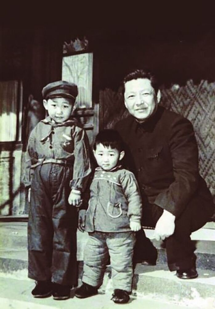 Xi Jinping (born in 1953, the General Secretary of the Communist Party of China since November 2012, left), Xi Yuanping (born in 1956, younger brother of Xi Jinping, middle) and Xi Zhongxun (born in 1913, Xi Jinping and Xi Yuanping's father, former Vice Premier and secretariat member, right) were together in 1958.