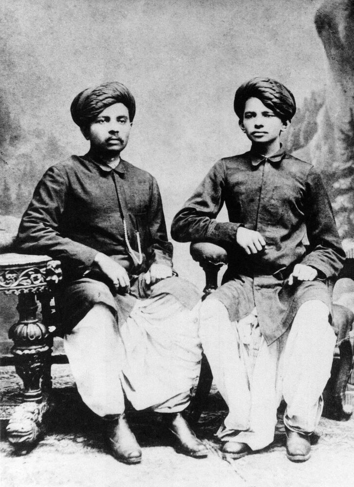 Indian politician Mahatma Gandhi with his brother, 1886.