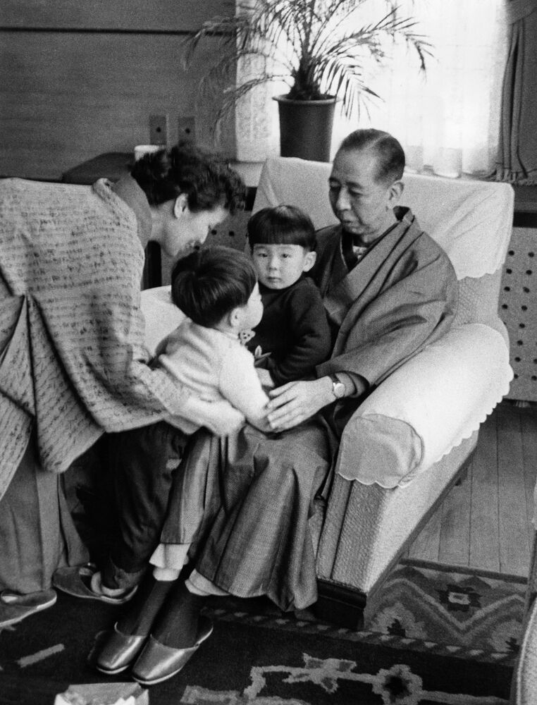 Family picture of Nobusuke Kishi, Prime Minister of Japan, and his wife Ryoko in a Japanese traditional costume (kimono) with their grandsons Shinzo Abe and Hironobu Abe (on the lap of his grandfather). Undated photo, probably taken in the 1960s and undefined location, probably in the prime minister's official residence in Tokyo, Japan.