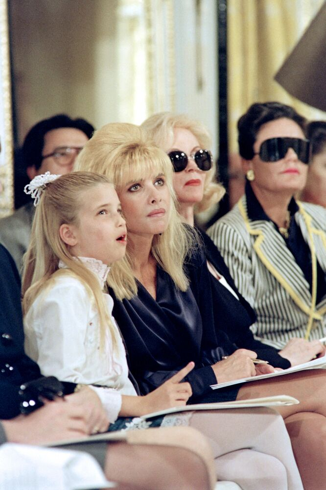 Ivana Trump (2ndL), flanked by her daughter Ivanka (L), attends the showing of the 1991 Fall collection of fashion designer Carolyne Roehm on 10 April 1991 in New York.