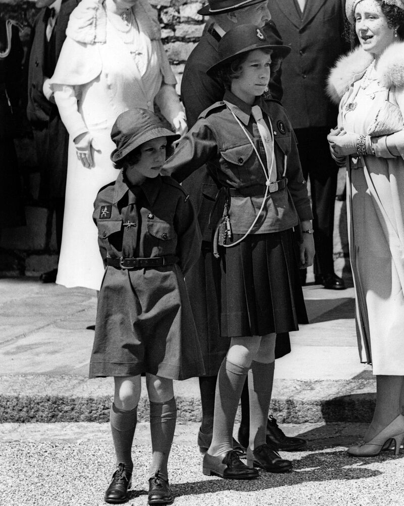 Picture taken on 1938 at Windsor Castle showing Princesses Margaret and Elizabeth, the future Queen Elizabeth II, during a girl Guides rally.