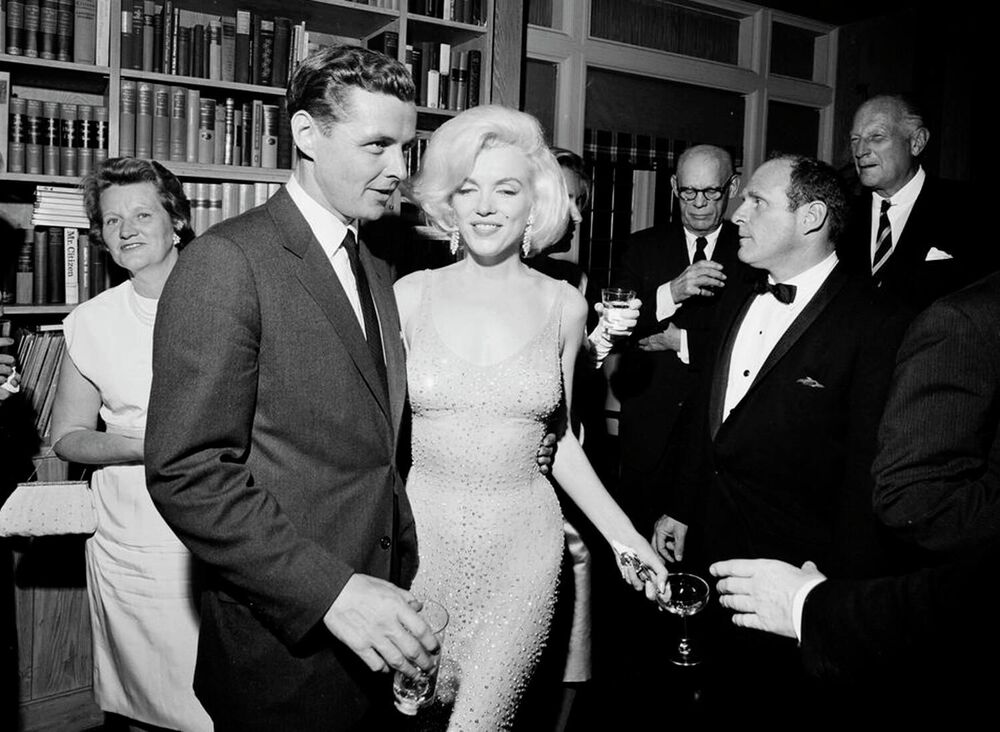 In this photo provided by the John F. Kennedy Presidential Library and Museum,  Marilyn Monroe wears the iconic gown that she wore while singing Happy Birthday to President John F. Kennedy at Madison Square Garden, during a reception in New York City.