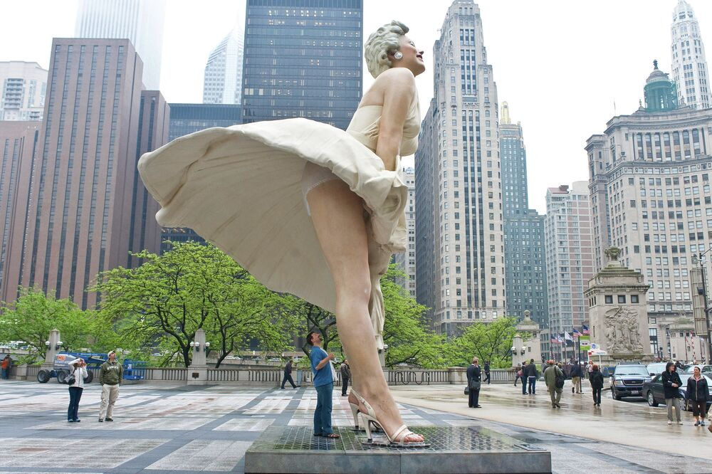 Tourists get a last look before the sculpture of Marilyn Monroe is dismantled as it prepares to travel to Palm Springs, California on 7 May 2012 in Chicago, Illinois.