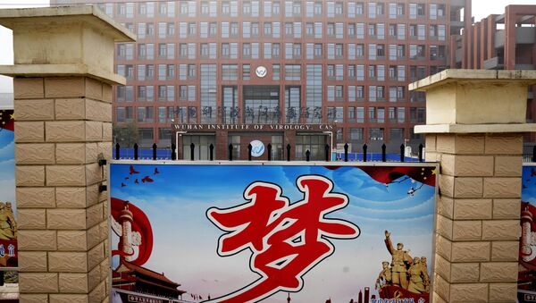 The Wuhan Institute of Virology is seen near the Chinese character for Dream during a visit by the World Health Organization team in Wuhan, China, Wednesday, Feb. 3, 2021 - Sputnik International