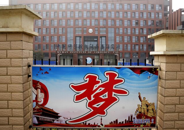 The Wuhan Institute of Virology is seen near the Chinese character for Dream during a visit by the World Health Organization team in Wuhan, China, Wednesday, Feb. 3, 2021