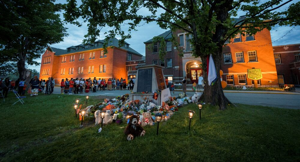 Kamloops residents and First Nations people gather to listen to drummers and singers at a memorial in front of the former Kamloops Indian Residential School after the remains of 215 children, some as young as three years old, were found at the site last week, in Kamloops, British Columbia, Canada May 31, 2021