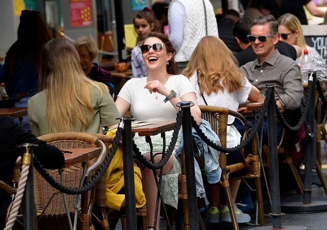 People relax at outdoor dining areas on the South Bank, as lockdown restrictions continue to ease amidst the spread of the coronavirus disease (COVID-19) pandemic, in London, Britain May 28, 2021