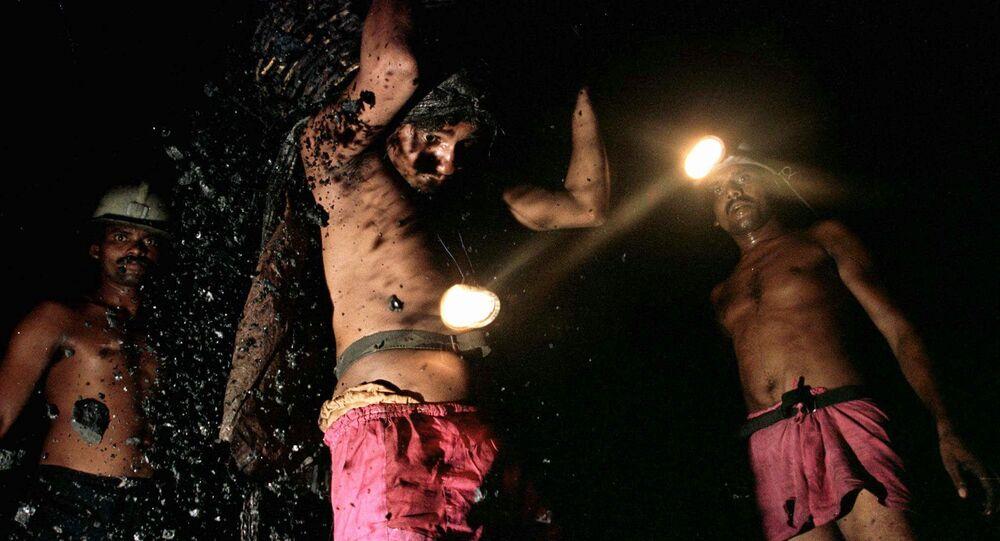 Miners haul coal in a shaft mine , India (File)