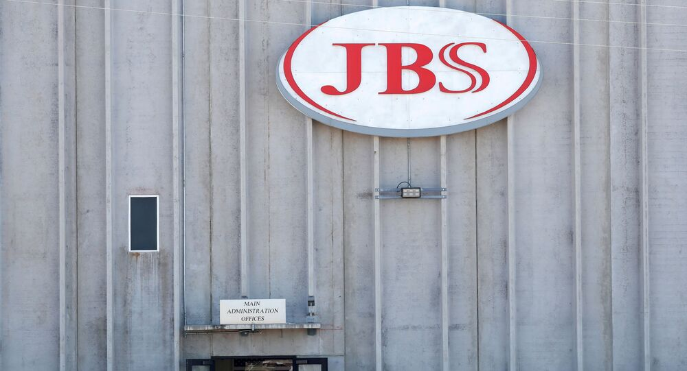 Employees walk around with face masks at the JBS USA meat packing plant, which  was closed after numerous employees tested positive and two have died from the coronavirus disease (COVID-19), in Greeley, Colorado, 14 April 2020