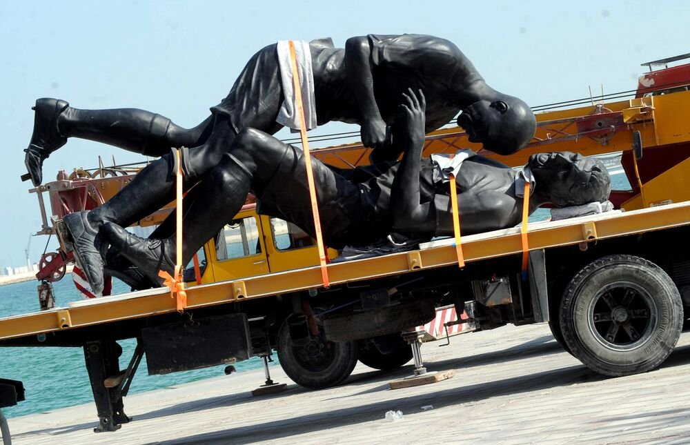 Coup de Tete, a 5-metre statue by Algerian-born French artist Adel Abdessemed commemorating the headbutt French footballer Zinedine Zidane gave Italian defender Marco Materazzi in the final of the 2006 Fifa World Cup is removed from Doha's corniche in Qatar on 30 October 2013 after local Islamists objected to it as a work of anti-Islam idolisation. It is now on display in the Arab Museum of Modern Art.