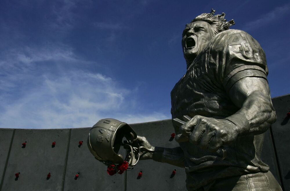 A statue of American Football player Pat Tillman Jr (1976-2004). The athlete and soldier who was killed in Afghanistan after quitting the NFL's Arizona Cardinals to join the US Army Rangers, was honoured with a statue outside the University of Phoenix Stadium before the game between the Arizona Cardinals and the Dallas Cowboys on 12 November 2006 in Glendale, Arizona.