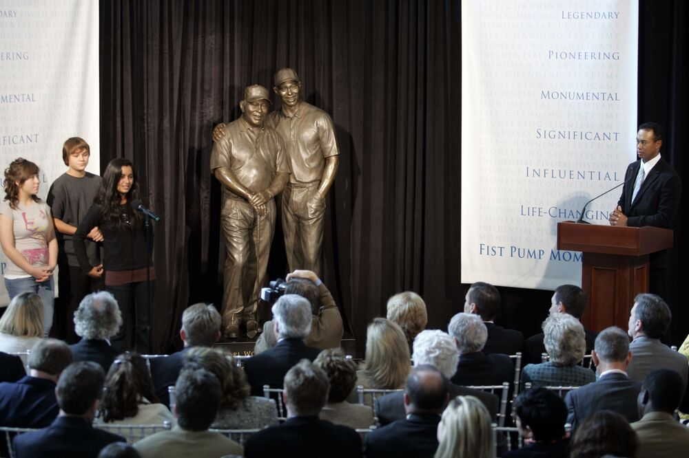 Tiger Woods unveils a bronze statue of himself with his late father Earl Woods, at the Tiger Woods Learning Center while announcing the launch of a nationwide youth programme called the Fist Pump Challenge in Anaheim, California on 21 January 2008.