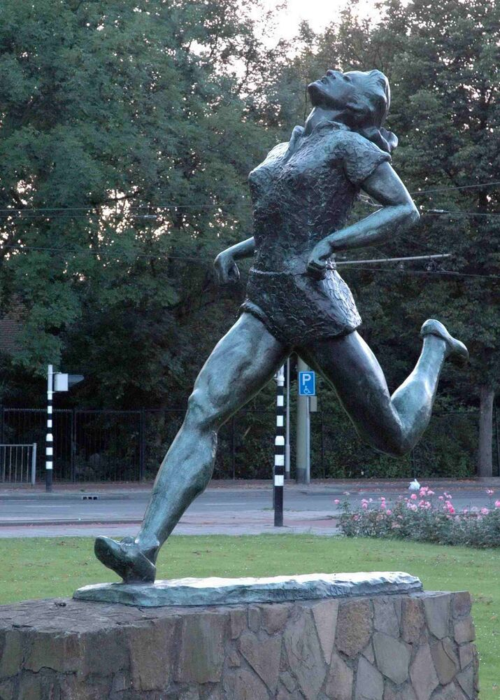 Statue of Olympic champion Fanny Blankers Koen (1918-2004) in Rotterdam, Holland. She was the first woman to win four Olympics gold medals.