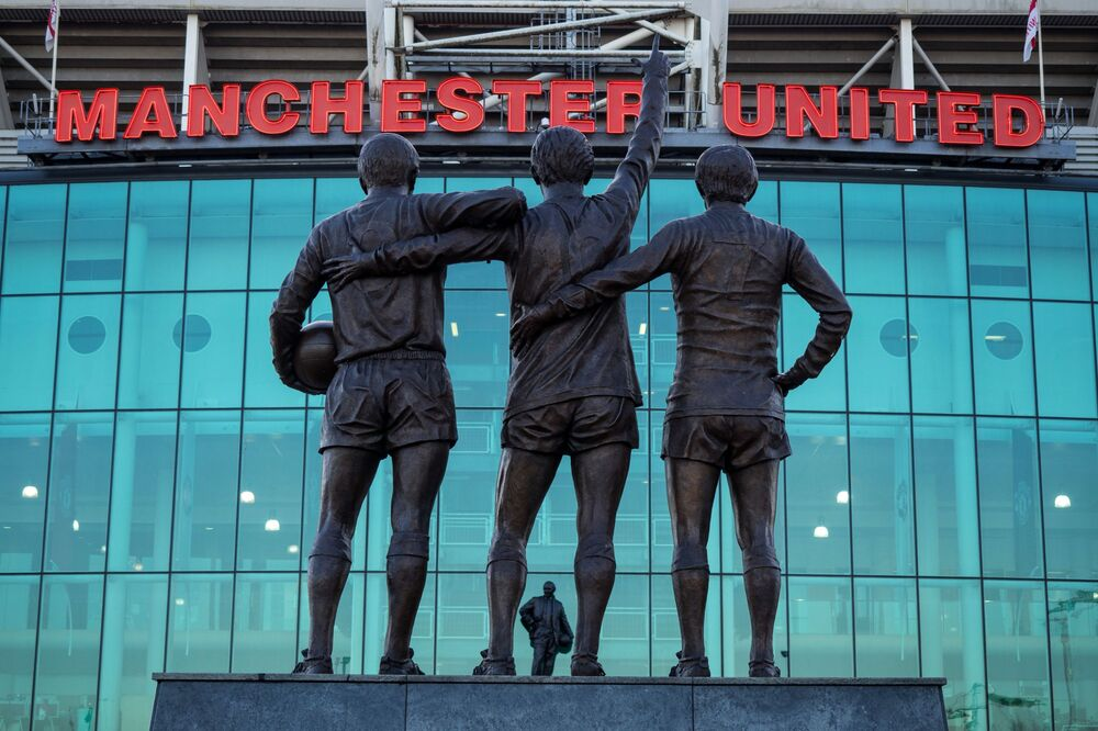 A monument to the Manchester United trio of George Best, Denis Law and Sir Bobby Charlton called The United Trinity is seen outside Old Trafford stadium in Manchester. The three players helped United to become the first English team to win the European Cup in 1968.