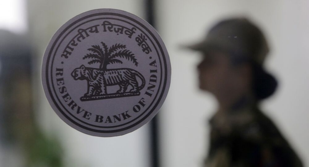 A security person stands guard outside the Reserve Bank of India in Mumbai, India, Wednesday, Dec 5, 2018