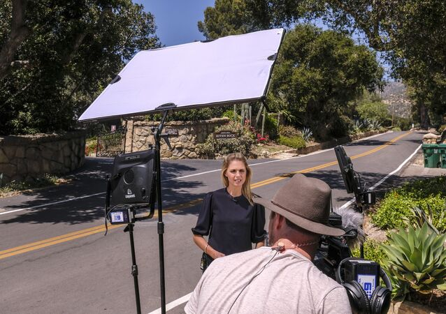 Members of media are seen near a community gate of the home of Prince Harry The Duke of Sussex and Meghan Markle The Duchess of Sussex after the announcement regarding the death of Britain's Prince Philip, Friday, April 9, 2021, in Montecito, Calif.