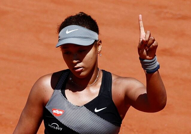Tennis - French Open - Roland Garros, Paris, France - May 30, 2021 Picture taken May 30, 2021 Japan's Naomi Osaka reacts during her first round match against Romania's Patricia Maria Tig