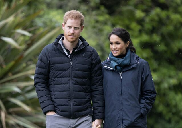 Britain's Prince Harry and Meghan, Duchess of Sussex walk together at Abel Tasman National Park in New Zealand, 29 October 2018