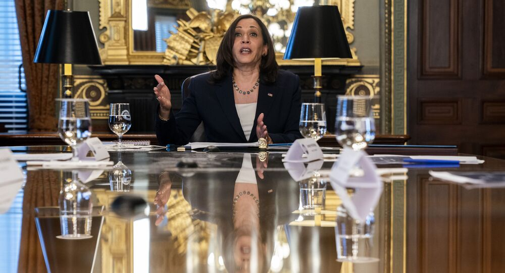 Vice President Kamala Harris is reflected in a table as she speaks during the inaugural meeting of the Task Force on Worker Organizing and Empowerment, in Harris' ceremonial office, Thursday, May 13, 2021, on the White House complex in Washington